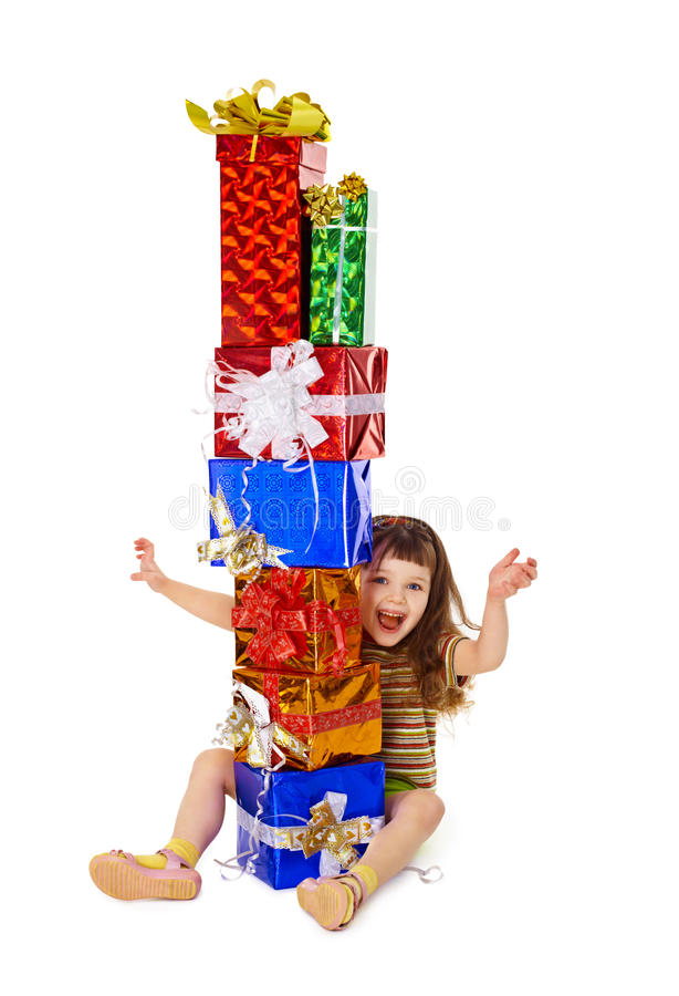 Very happy child enjoys on holiday gifts. A very happy child enjoys on holiday gifts isolated on white background royalty free stock photo