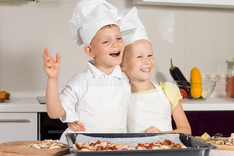 Very Happy Little Chefs After Baking Pizza stock photo