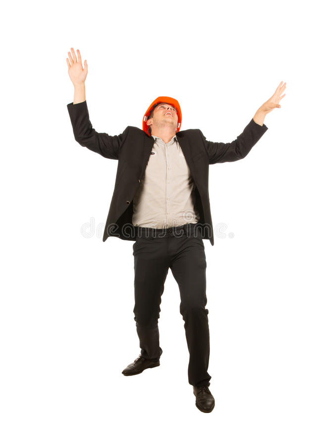 Very Happy Young Male Engineer on White Background. Very Happy Young Male Engineer Wearing Black Coat and Pants Isolated on White Background stock image