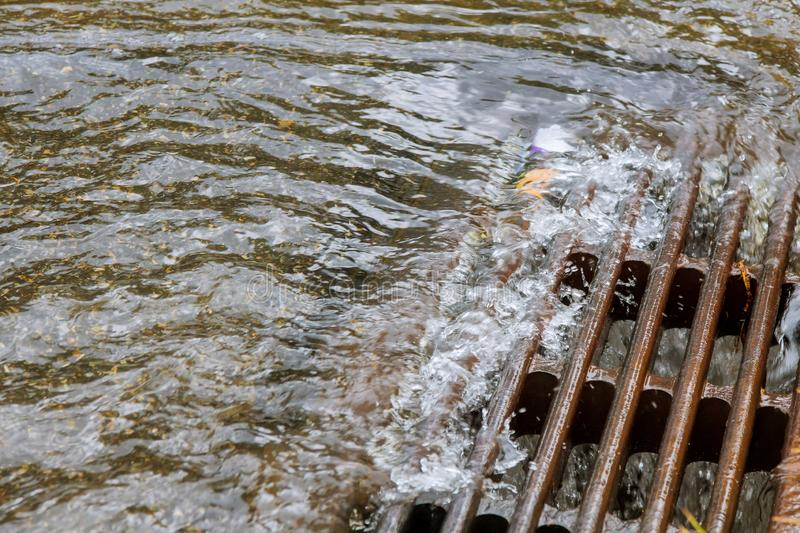 Very heavy rainfall the water caused by heavy rain drains into the sewers immediately. Very heavy rainfall in the water caused by heavy rain drains into the royalty free stock photos
