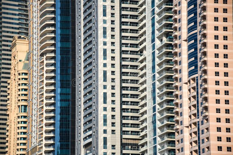 Very high skyscrapers close up of windows and balcony`s of crowded residential buildings stock photo