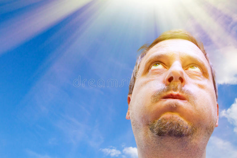 A very hot day. Portrait of a man in the hot sun stock image
