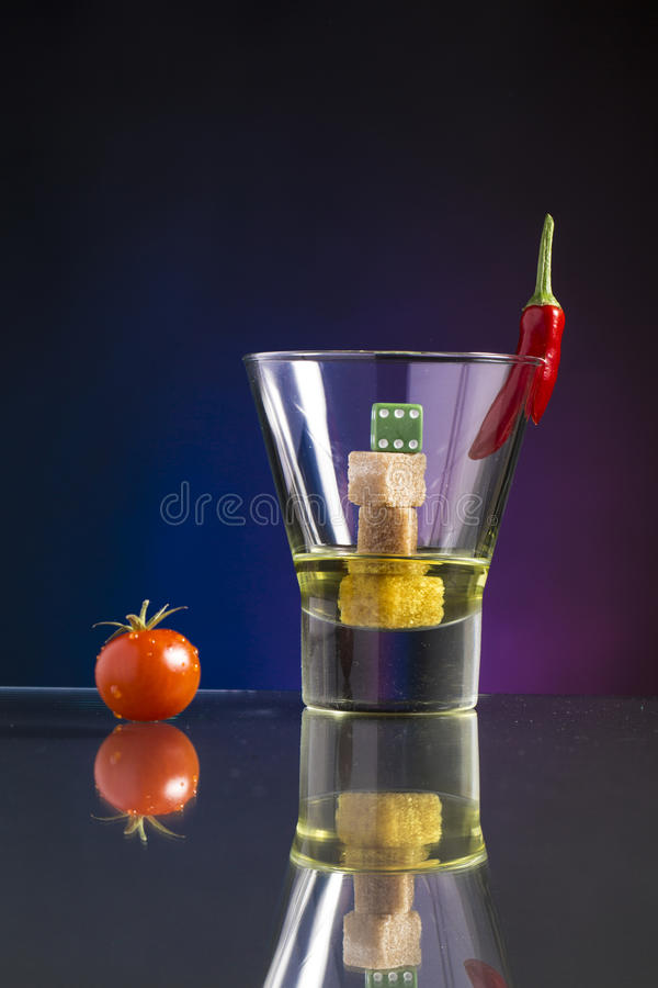 Very hot and sweet cocktail with cube sugar and chili stock photography