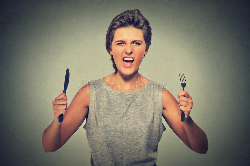 Very hungry young woman screaming displeased royalty free stock photos