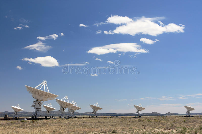 Very Large Array. Of radio telescopes against clouded blue sky royalty free stock photos