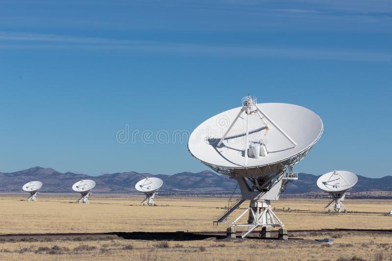 Very Large Array arrangement of radio telescope dishes in the desert, winter, science and technology. Copy space, horizontal aspect stock photography