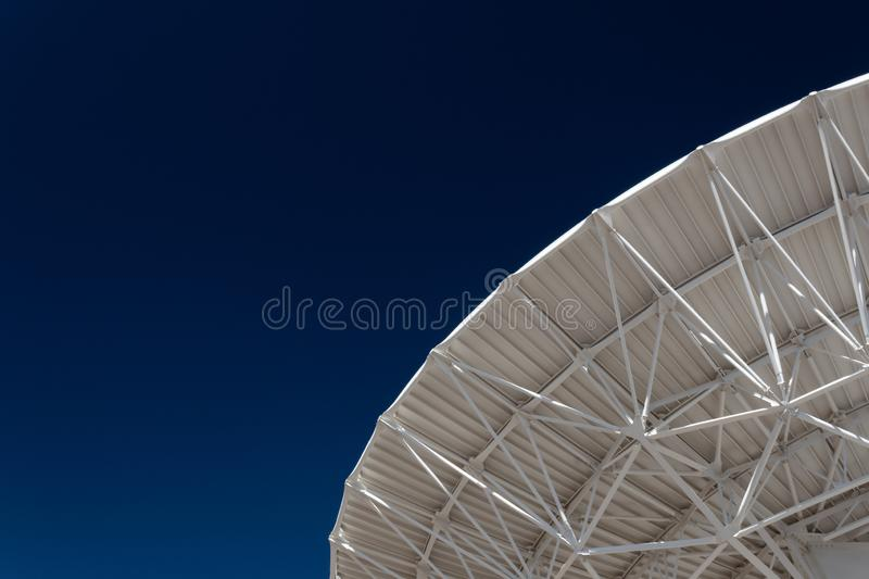 Very Large Array expanse of deep blue sky with radio telescope satellite dish, science technology stock photos