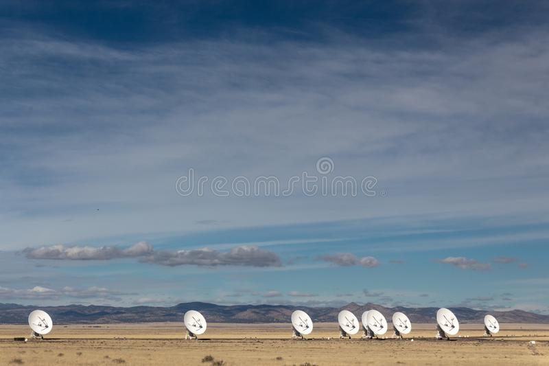 Very Large Array line of radio antenna dishes in the winter desert, space science and technology. Horizontal aspect royalty free stock photos