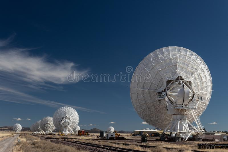 Very Large Array line of radio astronomy telescopes seen from the rear, science technology. Horizontal aspect stock images