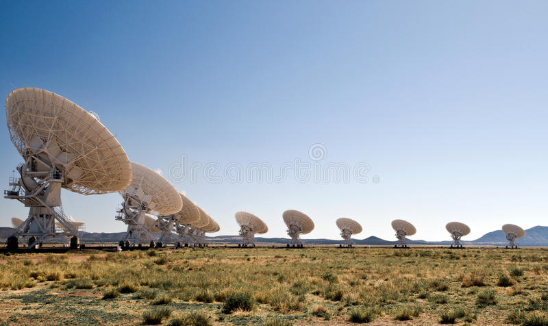 Very Large Array, New Mexico. Some of the 27 huge radio telescopes arrayed in close formation west of Socorro, New Mexico to probe the secrets of the universe royalty free stock images