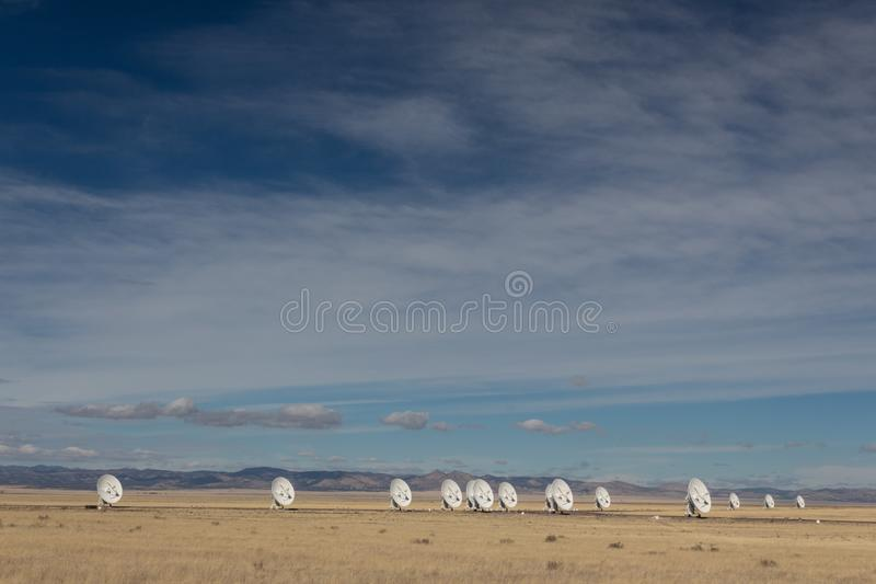 Very Large Array New Mexico desert, arrangement of radio astronomy observatory dishes. Copy space, horizontal aspect royalty free stock images