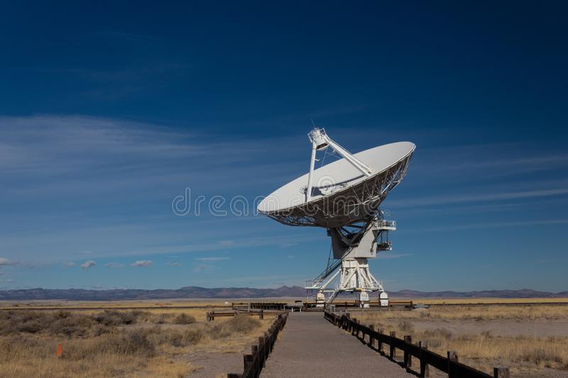 Very Large Array path to a radio antenna dish of the VLA in the New Mexico desert, space astronomy technology. Horizontal aspect stock photos
