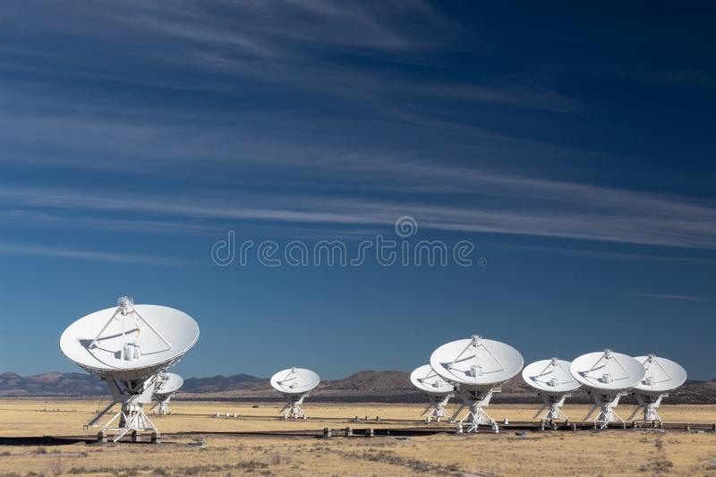 Very Large Array of radio astronomy observatory dishes in the New Mexico desert, space exploration, science technology. Horizontal aspect royalty free stock photography