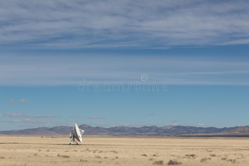 Very Large Array single radio astronomy dish alone in the desert, science technology space. Horizontal aspect royalty free stock photography