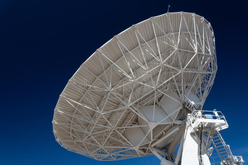 Very Large Array space, science technology huge radio satellite dish antenna pointing into a deep blue sky. Horizontal aspect stock images