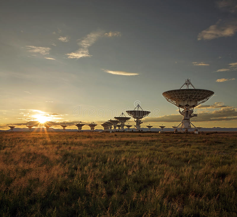 Very Large Array at Sunset (Satellite Dishes). The Very Large Array (group of satellite dishes used to probe deep space, as seen in Contact) are seen at sunset royalty free stock photos