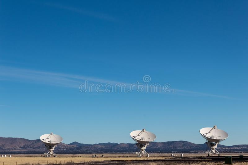 Very Large Array three very large radio telescope dishes in the New Mexico desert, winter. Copy space, horizontal aspect stock images