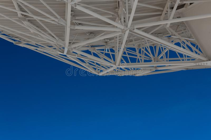 Very Large Array understructure of a large radio telescope dish with blue sky below, creative copy space, science technology. Horizontal aspect royalty free stock photography