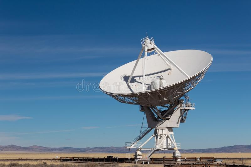 Very Large Array VLA radio antenna dish against a blue sky in the New Mexico desert, technology space exploration science. Horizontal aspect stock photography