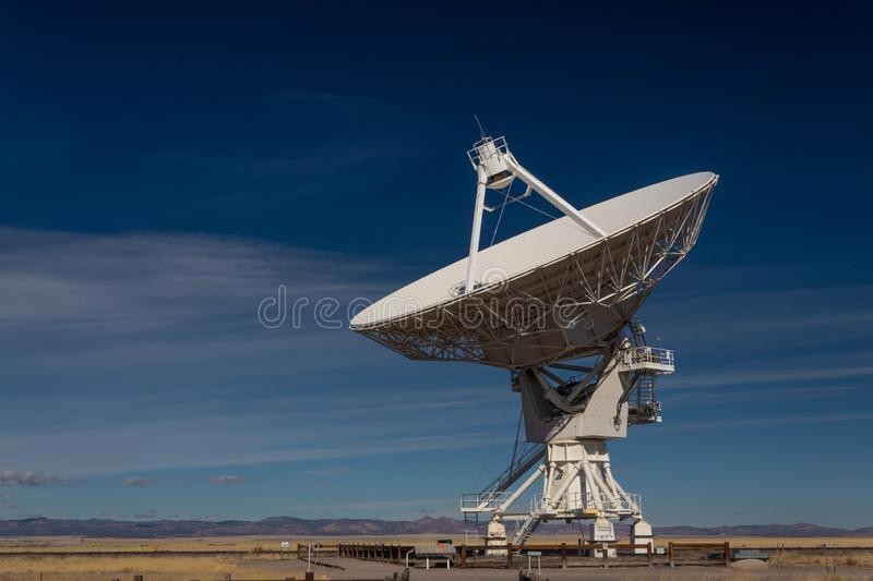 Very Large Array VLA radio antenna dish on pad in the New Mexico desert listening to the cosmos. Horizontal aspect royalty free stock photo
