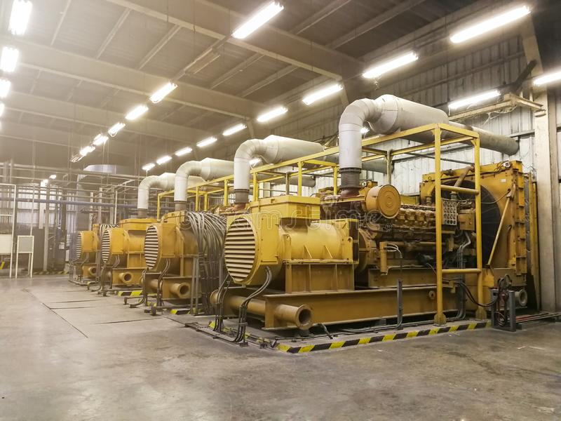 A very large electric diesel generator in factory for emergency,equipment plant modern technology industrial royalty free stock image