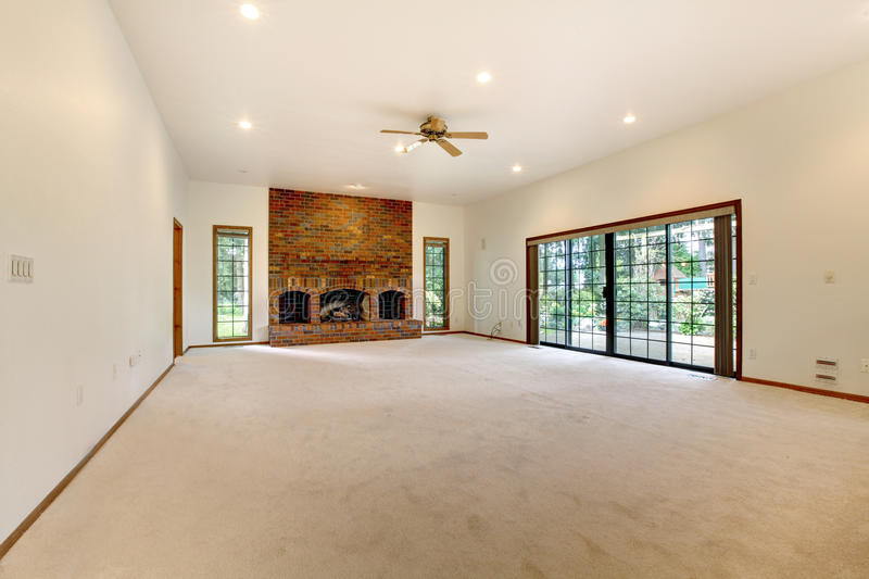 Very Large Empty Living Room With Brick Fireplace. Royalty ...