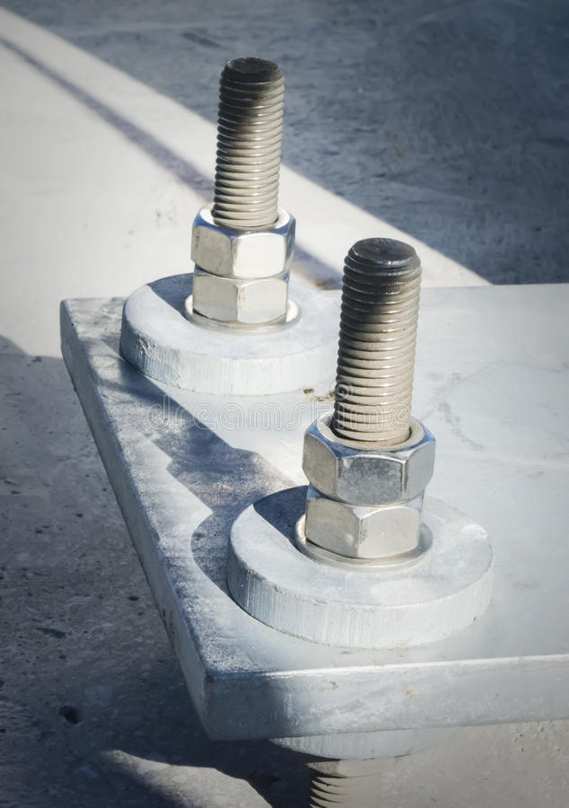 Very large nuts and bolts for bridge construction. Huge nuts and screws for construction work, like building bridges stock image