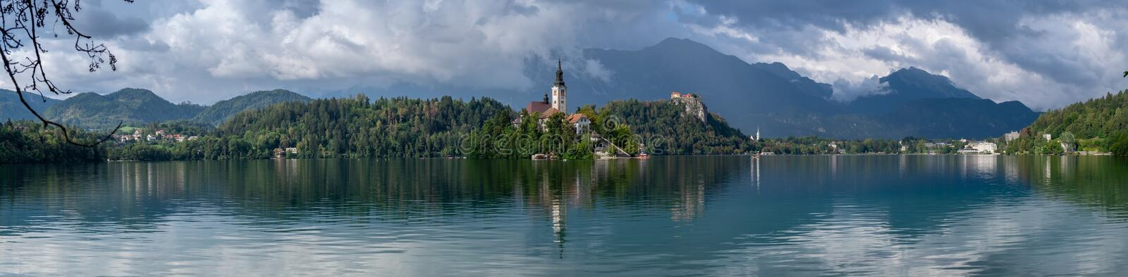 Very large panoramic view on The Church of Mary the Queen, located on an island in Lake Bled. Slovenia royalty free stock image