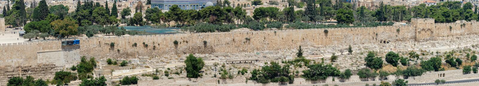 Large panoramic view of Jerusalem`s Old town Walls and old cemetery royalty free stock photography