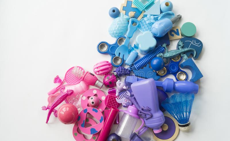 Rows of colorful rainbow toy bears.Very many kids toys rainbow color.Kids toys frame on white background. Top view. Flat lay. Very many kids toys rainbow color royalty free stock images