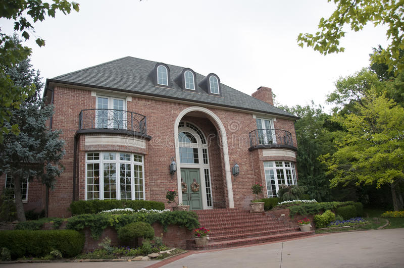 Very nice brick home. This is a very nice brick home with a large front door stock photography