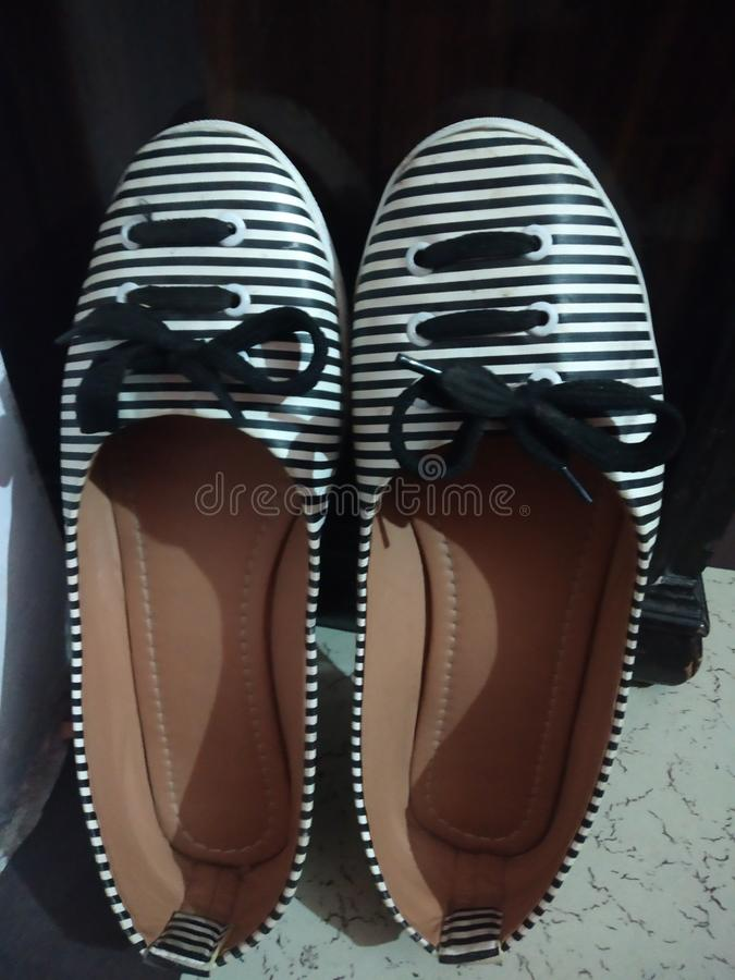 Very nice ladies shoes it is colour of black and white. stock photo
