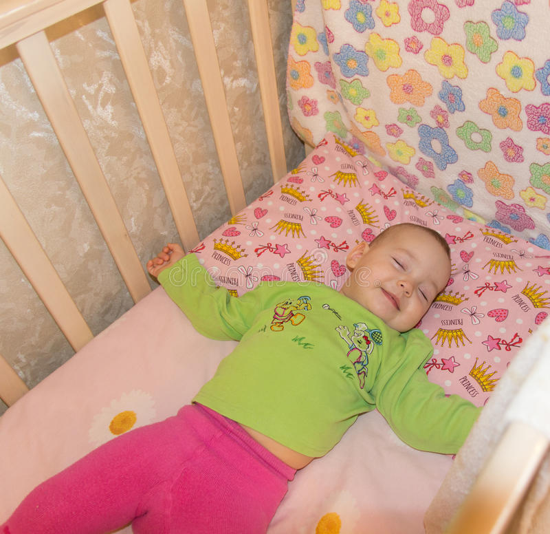 Very nice sweet baby sleeping in crib royalty free stock images