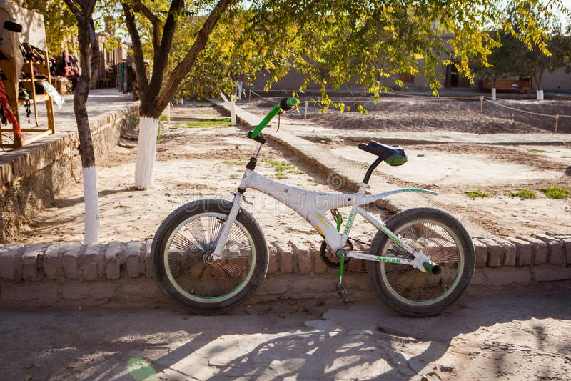 Very old bicycle. In inner yard of Inner yard of ancient Khiva City, Khorezm Region, Uzbekistan, Middle Asia. October, 2016 royalty free stock images