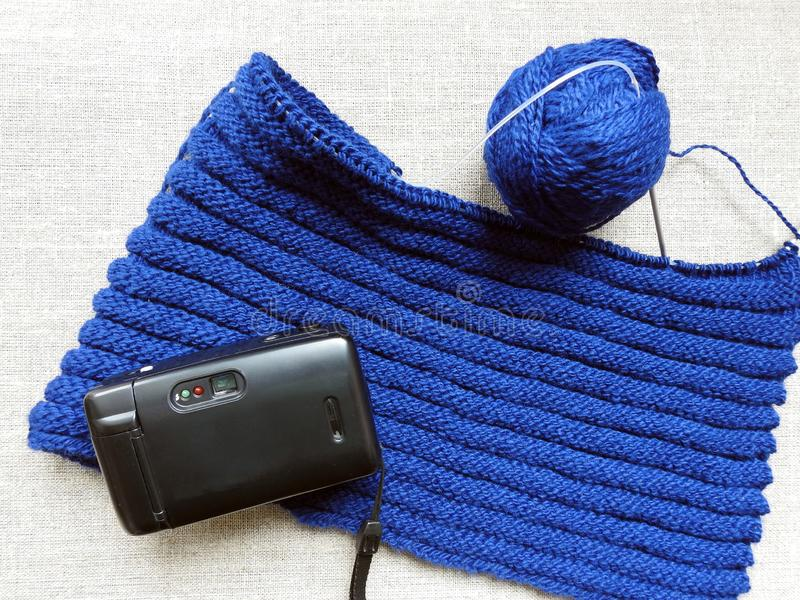 Old camera and blue knitting, Lithuania royalty free stock photo