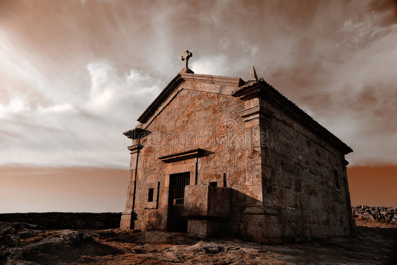 Very old Chapel in mountain stock photography