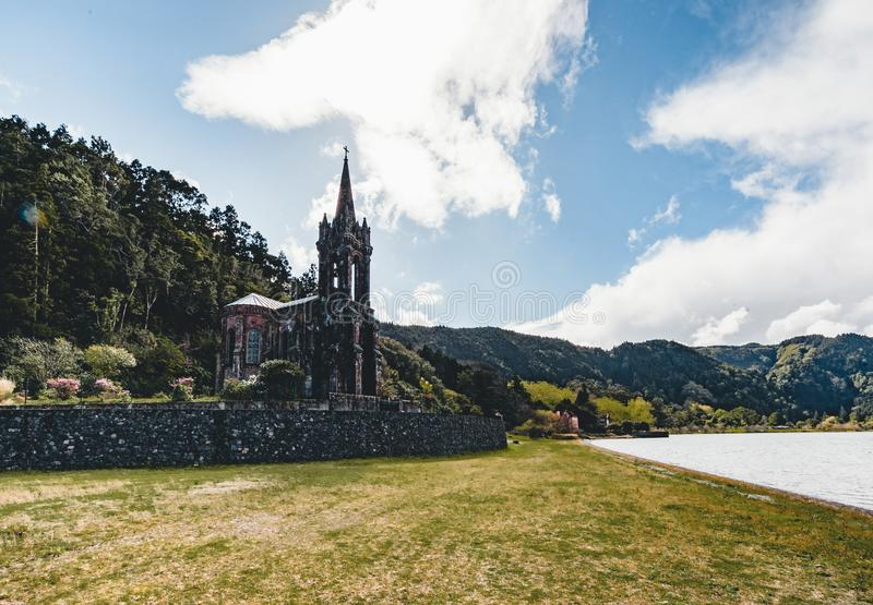 Very old church near crater lake Furnas on Sao Miguel Island named Chapel of Nossa Senhora das Vitorias. Perish of stock images