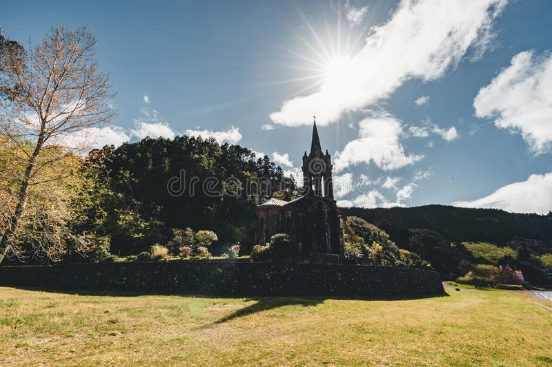 Very old church near crater lake Furnas on Sao Miguel Island named Chapel of Nossa Senhora das Vitorias. Perish of. Furnas. On the largest volcanic island in royalty free stock photography