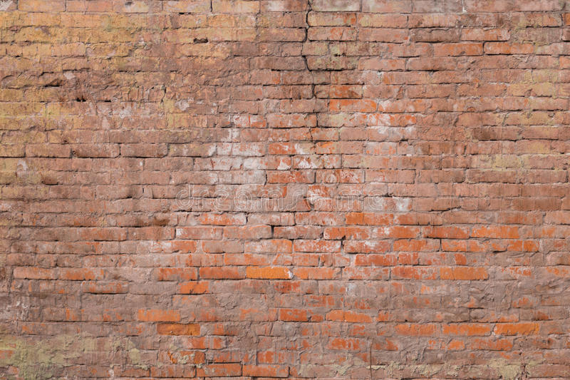 Very old clay brick wall of red-brown color royalty free stock image