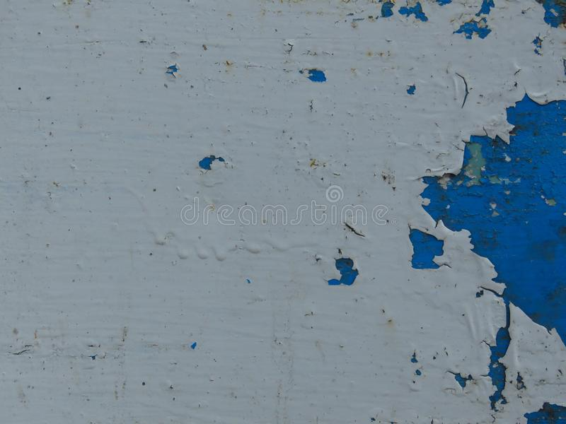Very old dirty peeled white and blue paint background. Suitable for background with space for text stock photography
