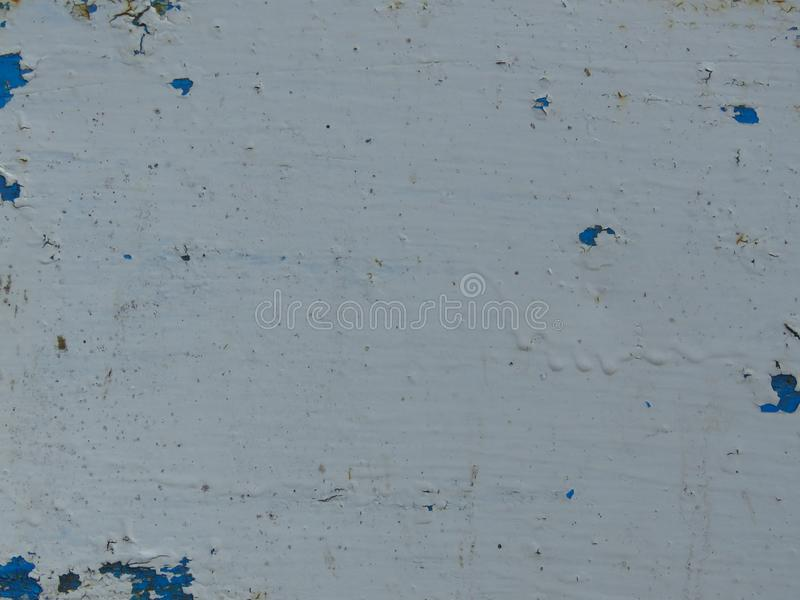 Very old dirty peeled white and blue paint background. Suitable for background with space for text royalty free stock photo