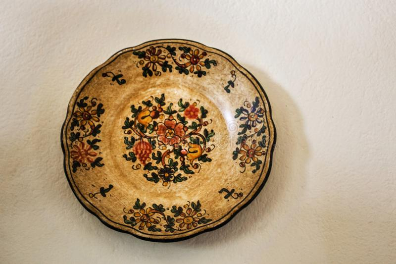 Very old dish. The dish came from Spain, and today and it is a decorative piece of the wall of the farm royalty free stock photo
