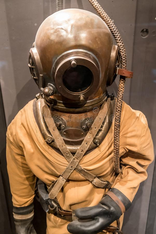 Old diving suite. Very old diving suite. Fully equipped stock images