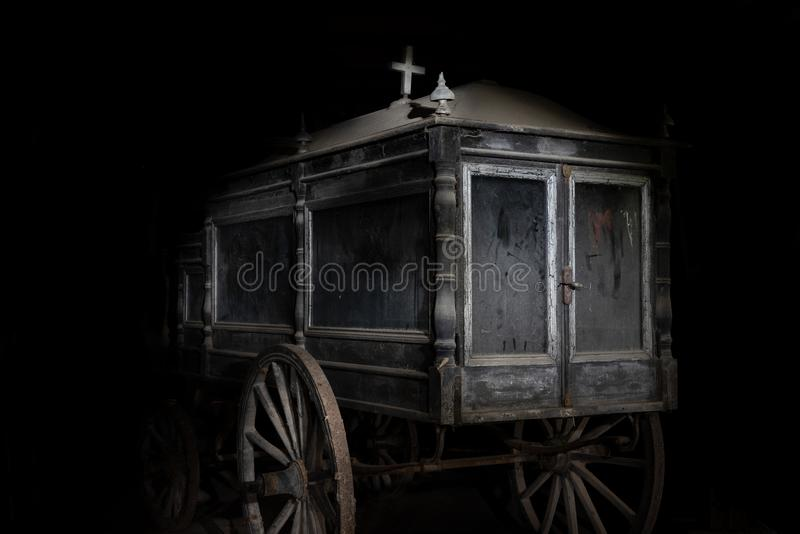 Old abandoned and dusty hearse carriage stock photography