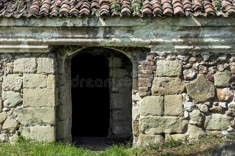 Very old entrance door and stone wall on antique building royalty free stock photo