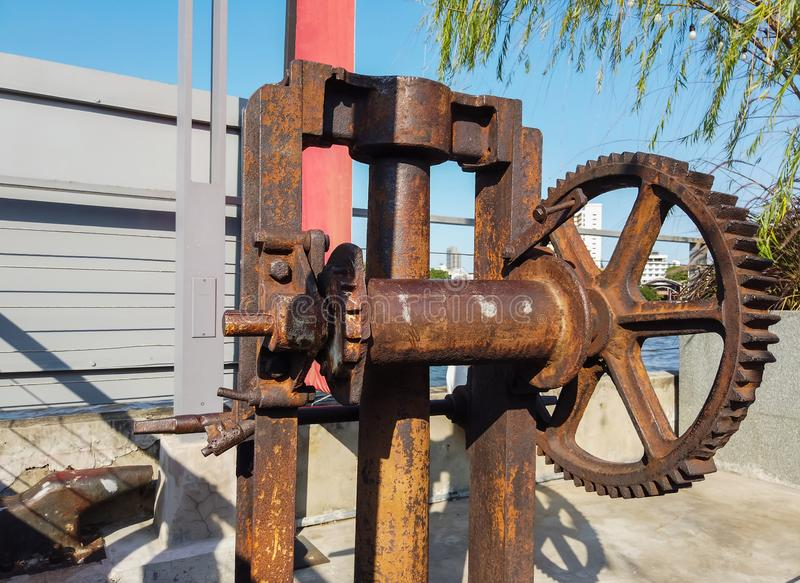 Very old factory gear, antique factory machinery with cogged wheels that rust stock photo