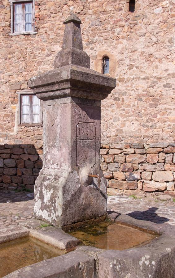 Very old fountain in a mountain village royalty free stock images