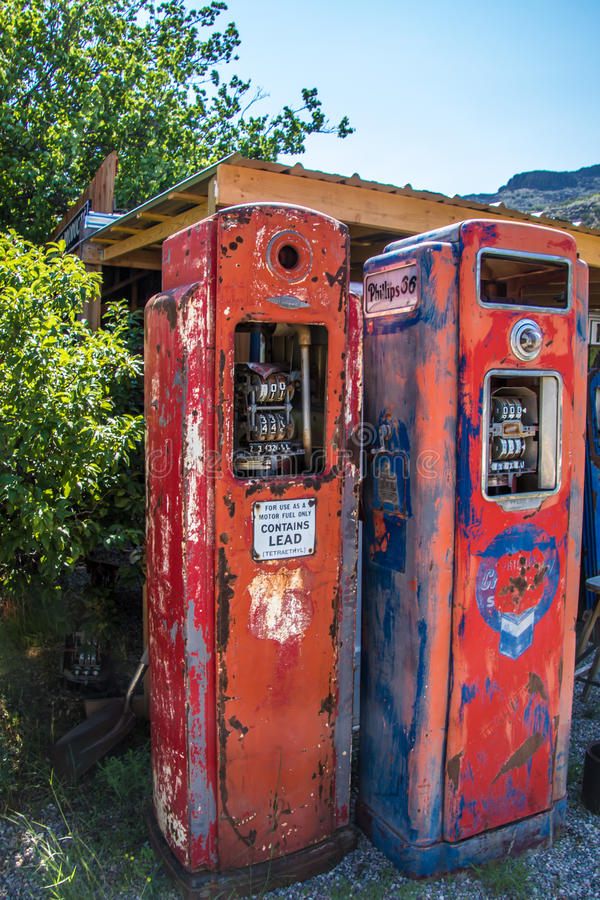 Very old gasoline pumps beside a 2 lane road in the middle of nowhere royalty free stock photo