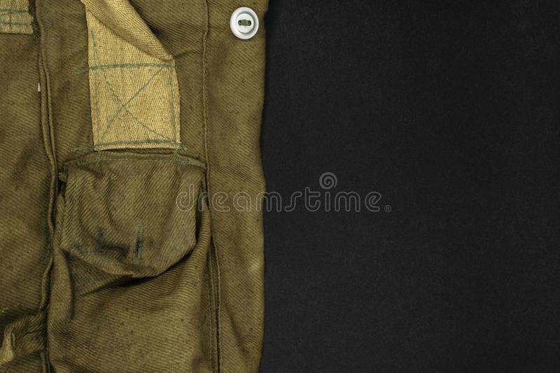 Very Old Green Military Bag for Gas Mask on Black Background Surface with Free Space stock photos