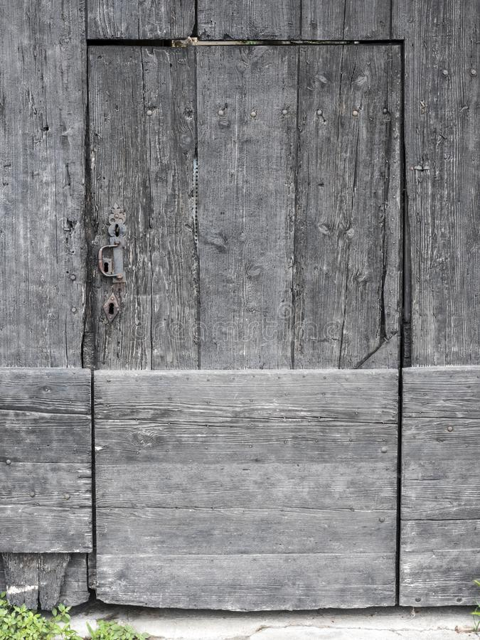 Very old grungy dark brown door in french provence royalty free stock image